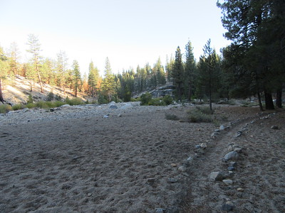 It is a large flat area about half a mile below the confluence of Mountaineer and Alpine Creeks, and where the resulting creek flows into the Little Kern River.  (I don't know whether it is officially called Mountaineer Creek or Alpine Creek after the confluence, but according to people I have met there over the years, it is both or either.)  The flat has rock lined trails going to, through and from it, ...
