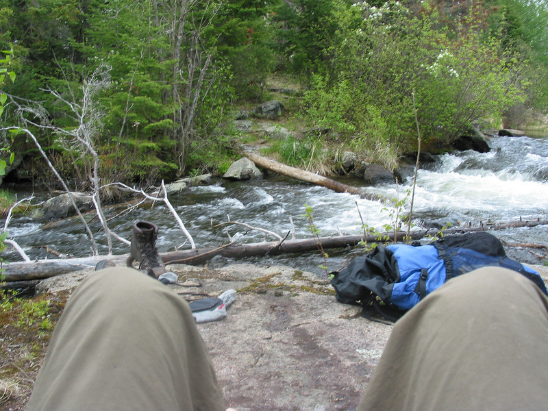 Preparing feet to cross this creek. I carefully taped the bottom of my rainpants to the tops of my boots and it kept most of the water out.