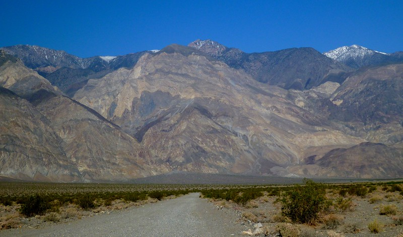 The gravel road into  Saline Valley has a lot of washboarding. Craig Canyon is left center, Little Hunter Canyon is on the right, and Keynot Peak is the snow peak at the upper right. The elevation difference from the road and the top of Keynot Peak is more than 10,000 feet.