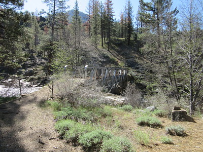 ... here crossing to the east side across the bridge near Grouse Canyon, with a ...