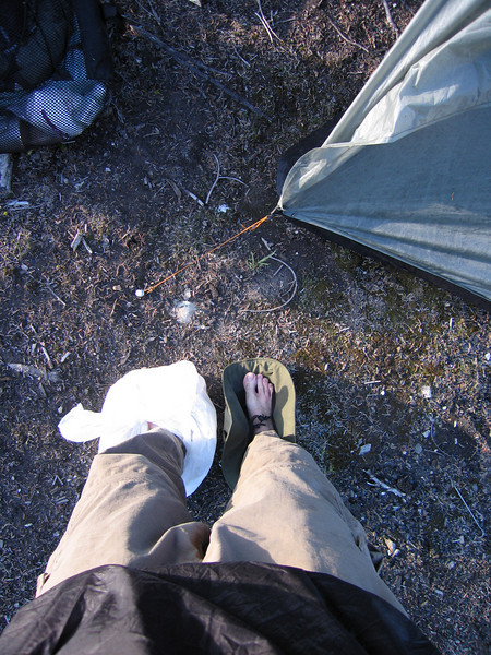 Day 7: When you take off your wet shoes at camp you have to improvise to avoid walking around barefoot.