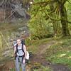 Scott standing next to a fallen tree, it was huge!