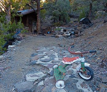 "We hiked up to a 1870's era cabin located in Sourdough Canyon. We liked this place better. It is called ""The Castle."" Note the tricycle."
