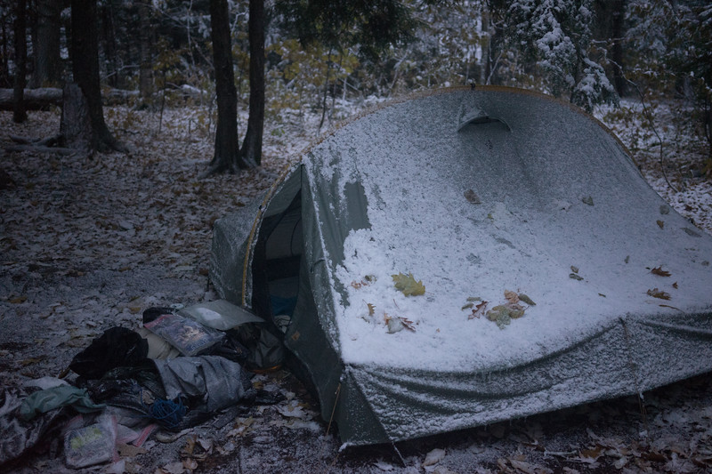 The next morning we awoke to 25 degrees and snow! It continued to come down while we broke camp. Neiko woke us up at 4 am shivering. I put my down parka over him and he warmed up.