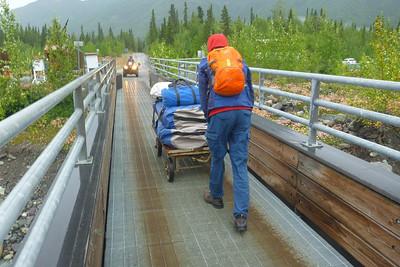 Taking gear across the McCarthy pedestrian  bridge.