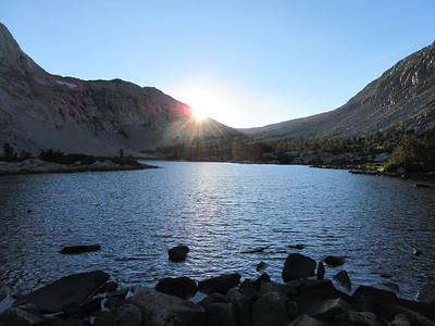 On my final evening there, I took this shot looking west over the lake at the sun setting near Piute Pass, and then ...