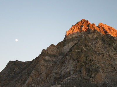 ... a look east provided this view of the moon rising and the final sunshine glowing on the top of a nearby peak.