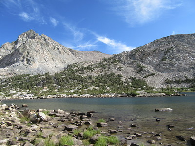 A look across Piute Lake at a rock building which ...