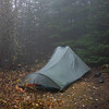 """The weather took a change for the worse right as we chose this campsite near an """"alpine"""" lake. It proceeded to rain and be foggy from 11:30 am to 4:00 pm. We spent most of this time in our small tarptent reading."""