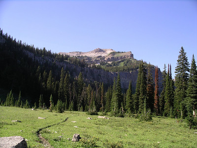 The meadows below Sock Lake, the lake sits up just under the cliffs at the top of this picture.
