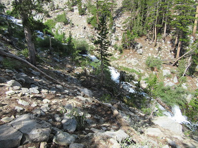 The trail again neared a cascade flowing down the canyon, ...