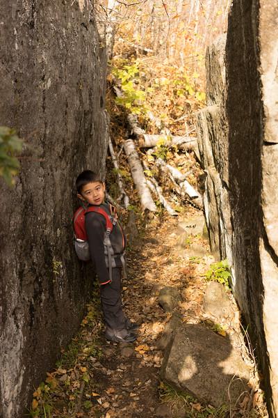 A natural rock corridor along the trail.