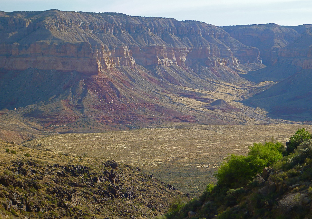 The Shaman panel is located in upper Tuckup Canyon in a line with the small knoll seen in the center right of this photo.
