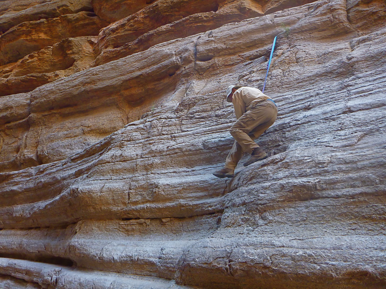 "The other steep part is near the bottom which turned out to be easy when we looped our sling over a ""Nail"" driven into the rock."