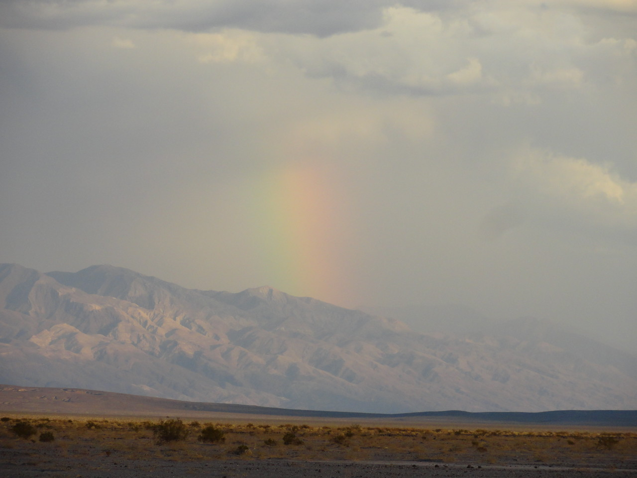 Rainbow after rare storm in Death Valley