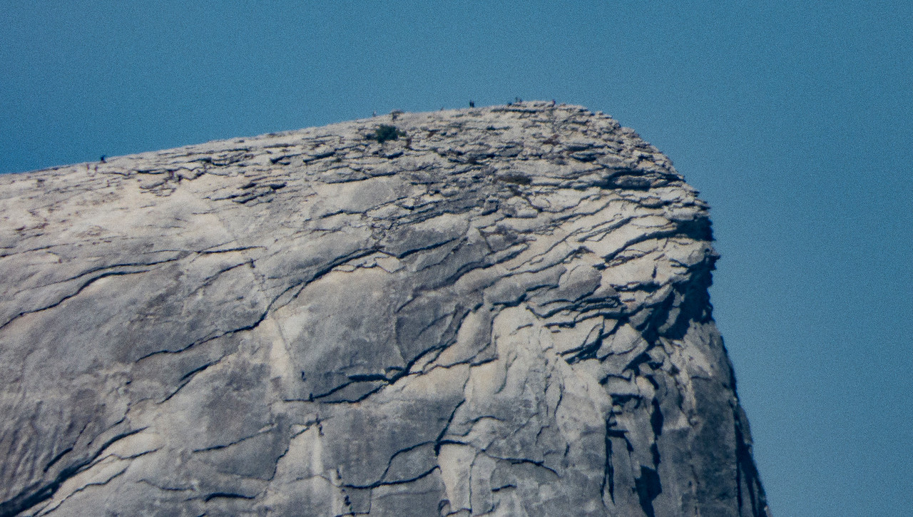 Climbers on the cables and the summit of Half Dome