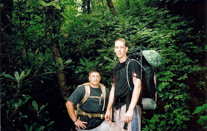 My journey takes me down from Big Fat to Slickrock Creek where I spend the night at Wildcat Falls and then on Day 5 I start my 9th climb up the Nutbuster trail.  Along the way I run into Doug on the left, an Iraq War vet who lost his right eye in a grenade attack.  We hiked together up the Nutbuster trail until I veered off to set up at Buckeye Camp.<br /> <br /> JOURNAL TRIP 48<br /> <br /> DAY FIVE<br /> <br />  I hear the infrequent patter of raindrops hitting my shelter but it isn't raining, it hasn't rained in 7 hours so it must be the q-tip treetops catching the low valley fog and in saturation loosening its load one drop by one. It is very dark in this place and first light won't be here for 5 hours so why am I up? Mr Bladder poked me in the medulla and so here I sit listening to the creek and penning thoughts in yet another Citico/Slickrock trip report.<br /> <br />     Ken Jones told me he saw ATV tracks running from Beech Gap and along the Cold Spring Gap trail and up the BMT connection a ways and he reported the violation to the Ranger station in Tellico. God I hope I never run into those motorized meatheaded gas-addicted fellows!<br /> <br />     First or second light has come to the dark Slickrock valley as I slowly prepare to cook and gear up for my backpack up the Holy Nutbuster, perhaps to see the Savannah boys, perhaps to camp at Buckeye, perhaps to wait a while and survey the sky, cloudy or otherwise?<br /> <br />     Ok, I left Wildcat Camp and crossed Slickrock twice and started up the Nutbuster trail when I saw soldier Doug and his friend Robert so I depacked and rock hopped the creek to their Slicnic site and invited myself to share their hike up the Nutbuster where I peeled away to Buckeye Camp as they continued their sweaty trip up section 4 of the You Weep -- We All Weep Trail.<br /> <br />     OVERNIGHT AT BUCKEYE CAMP: Incense is lit and I'm about ready for an incomplete swim in Hangover creek which is 10 yards and flowing loudy by my camp which is exactly the reason this place is so nice. I pray that Grandfather spirit blesses soldier Doug and keeps him healthy and safe for not only this trip but for afterwards, too.<br /> <br />     All right, Day 5 slowly comes to an end as darkness creeps up on Buckeye Camp and leaves Shunka and me preparing for the prone position. The rain came to us on section 3 today but it wasn't much, just a slight drizzle and some leaf drops, nobody got wet. Tomorrow I will follow in the footsteps of Doug and Robert and climb the 7 remaining sections of the Nutbuster trail. Wish me luck and clear skies on my 9th challenge to enjoy this trail.<br /> <br /> -Tipi Walter