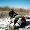 I return to my tent on the Bob in Raven Camp and contemplate gearing up and shoving off.<br /> <br /> TRIP 42 JOURNAL<br /> <br /> DAY EIGHT<br /> <br /> TRAIL  54A South/Skyway BMT/Mud Gap<br /> CAMP  Whiggs Meadow<br /> <br />  MORNING ON THE BOB: Dawn greets me in 5 degrees as I consciously decide to not leave the tent until the sun glints off the crystal ice adhering to its sides. Today will be an important one of movement down to the warmer climes of waterways and big trees, of paths undulating to finally give up the fight and proceed downhill in one long swoop. But first comes the short steep uphills and the long 1.5 uphill to the Whigg from Mud Gap. The hardest part of my day will be packing up these frozen parts but as the sun ascends it will be easier. For the first 7 days I saw 24 people, 20 backpackers and 4 dayhikers. For the next week I will not see a soul, guaranteed.<br /> <br />     Let me now layer up and leave this nylon sanctuary, survival nest and zippered prison. The sun sure is nice here at the Rock Quarry! I left the Bob after boiling water to warm my feet and hiked down and out to Beech Gap where I got on the up and down BMT connector to where I sit now in the big open bowl on the Quarry.<br /> <br />     My goal today is the Whigg though with any luck I should be able to reach Rainbow Trail Camp or further. Let me bask and eat and I'll be on my way.<br />    <br />     OVERNIGHT ON THE WHIGG: Ok, here is my camp for Day 8 and my 10 miles for the day is done and I am pooped. I never realized how steep the Mud Gap trail is here to the Whigger, man it seemed straight up at times. I hear a raven calling out to me with his deep throated caruk! Caruk! Hello brother Raven! It is beautiful up here and not too cold, the warmth of the sun is cruel as nightfall will bring back the high elevation cold. Tomorrow is the day when we get permanently lower.<br /> <br />     Ok, dinner is finished and the pot cleaned and now I wait to layer up and put the fly on the tent. It feels very good up here, the sun is slowly setting and I am sitting up on my thermy partially enclosed in goose down looking over my journal and thinking of my journey tomorrow and the look of Horse Camp when I arrive. I have been missing Little Mitten and it hurts sometimes to be apart from her.<br /> <br />     Soon I shall be by the singing waters and that will be helpful and not long after I'll be in Tellico with her and god willing won't have to rush off to North Carolina when I get back. Even though my water jug is freezing up and during my recent pee break I shivered like a school child it is much warmer than the frigid experience of last night and I'm still at 5,000 feet.<br /> <br />     The Whigg is high above the city lights of many towns: Englewood, Tellico, Madisonville, Vonore and Maryville. Each place looks like it's on fire. My 5th candle has started and I have plenty more to last out the trip although this looks to be a long long night of sitting up with it and then trying to sleep but mostly waiting for first light and the joy of a full pack resting on my back as I comfortably descend 3,000 feet on a 7 mile boulevard of watersprings and little creek crossings. Tomorrow I hope to see the sun shine into my cold tent to get me started.<br /> <br /> -Tipi Walter