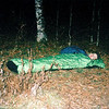 """I leave the Bob and head down to Naked Ground where I set up a couple hundred yards away at a spot I call Watauga Camp.  I return to the high gap and find a poor soul trying to stay warm all night in a bivy sac.  We have tents to go to, he has a body bag.<br /> <br /> JOURNAL TRIP 51<br /> <br /> DAY SIX<br /> <br />  MORNING AT WATAUGA CAMP: A predawn morning finds me outside tightening up the tent vestibule as a strong gale tears across the ridge in a wind whipped frenzy. It's been a constant freight train coming from the east and Four Mile Ridge is getting the worst of it as it runs for the most part north to south so it is in line for an easterly slapping. But let's face it, it sounds alot worse than it is as the green Nammy is silent and barely moving when it should be atwistin' and aflailin' and loudly aflappin' in this tumult.<br /> <br />     It isn't as cold as it could be as I am comfortably up without cold fingers or face. I wonder how the 2 large groups of backpackers and campers are doing on both sides of me, the 16 to my left at Naked and the several over at probably the windiest place on Saddle Tree. I think I'll probably be moving out today unless it rains inwhich case I'm staying put at beautiful Watauga Camp for awhile longer, I can do a water run with little effort.<br /> <br />     I expect at any moment to start hearing the wind-whipped pitter patter of a mountain rainstorm and I think of that Chattanooga boy stretched out on the ground in his blue Bibler bivy sack with head slot. I think I got a good photo of his quandary and troubled sleep. He layed down at 5:30 pm and so I'm sure he's wide awake now after only 12 hours of being cocooned in a $300 body bag. Let's just say it ain't for me, I can't remember the last time I """"bed rolled it"""" right on the ground. Here it goes:<br /> <br />                            JUST A BEDROLL<br /> *** Conehead Rhodo Grotto in the rain<br /> *** Big Foot bag in the wind at Oak Mother and the Dog<br /> *** Becko"""