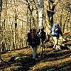 Three backpackers pass thru Naked Ground.