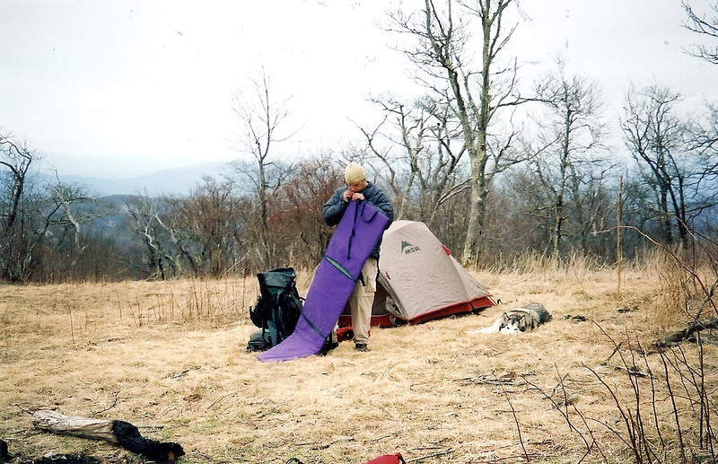 One of the 3 backpackers on the Bob gets ready for sleep as he stands next to his old MSR Fury tent.