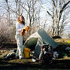 Amy decides to stay at 5,000 feet on Cheoah and so she sets up her Seedhouse tent.<br /> <br /> JOURNAL TRIP 57<br /> <br /> DAY FOUR<br /> <br /> MORNING AT BROWN FORK GAP: A predawn wake up gets me up and I see a bright moon peering down as I exit a dew covered and heavily moist tent though inside I am warm and dry. The air temp is cold but still and today's crossing of Stecoah Gap and the climb to Cheoah looks to be under the light of the yellow orb. It'll be cold up on the bald at 5,052 feet but I have my down jacket and gloves which will get me thru the higher elevations. In 2.6 miles I'll be at the gap and in 5.5 miles and 1,867 feet I'll be atop Cheoah so that's 8.1 miles for the day.<br /> <br /> Wow, at 8 am I reawaken in a frozen iced up tent! So, it's early April at 3,700 feet and it is still wintry despite the previous spring like weather. No one has passed my camp yet but they will very shortly.<br /> <br /> Ok, I left Brown Fork Gap and descended into Stecoah Gap where I sit now talking with 2 trail angels and their daughter and her husband who are thru hikers. I'm about ready to start the Cheoah climb so wish me luck.<br /> <br /> I left the gap and busted a nut up to Locust Cove Gap where I got 2 liters of water and then began the longest 2.5 miles of my life up to Cheoah Bald where I met several thru hikers and where I met Willow after a few minutes of waiting. She arrived and we had a great reunion where we set up the tents with several others. Let me say that the climb up from Locust Cove truly kicked my shrivelled medulla, I never though it would end! I wept like a child and got mean and hot but I finally made it though I found no water yet. I believe there's water down the Bartram trail a ways, just too tired to look. I scouted down from the bald a long ways but found nothing, sob, I guess Sassafras shelter is the closest place.<br /> <br /> Everybody's in their tents reading, writing or trying to sleep. I'm up filling out my journal and slowly 