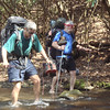 Kurt and Monte go slow on slippery rocks.