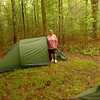 """Little Mitten likes her big Nammatj tent.<br /> <br /> DAY ONE   TRIP 134<br /> <br /> Entrance on Tellico River at Green Cove Cabin<br /> <br /> CAR CAMPING AT GREEN COVE CABIN<br />     Little Mitten and I drive up Tellico River road and pull into the old Green Cove cabin occupied by her dad Arrants. Among the crew are Jeremy and Kirstin and Mitten's son Blade along with Mitten's dad. I squeezed in two Hillebergs at the only level spots and of course have my standard Keron while Mitten is using its little brother called the Nammatj 3. She plans on using it with Zoe Dog and it's a perfect tent with a dog since it's wide with a big vestibule identical to the Keron. The weather is cool in the mountains along Tellico River and the noseeums are out in force so I have to smear on some herbal repellant and light a stick of incense.<br /> <br /> TELLICO RIVER<br />     It's located in the southern portion of the Cherokee NF and inside Monroe County TN. Green Cove is a 50 acre holding inside the Cherokee and right on the banks of the river. Downstream several 100 yards is the cabin and well off the road so privacy is ensured.<br /> <br /> SNAKE TALK<br />     A friend asks, """"Do you ever see any snakes?""""<br /> <br />     """"Yeah, alot.""""<br /> <br />     """"What do you do?""""<br /> <br />     """"I let 'em be. I sure don't kill them, it's bad karma.""""<br /> <br />     """"Well, I kill everyone I see.""""<br /> <br />     """"Not me. There are a small part of God's creation and this is their home. I didn't put them here, God made 'em.""""<br /> <br />     At this he got very quiet and I lost him.<br /> <br />     I rarely car camp so this gives all of us a chance to reconnect and socialize in a natural setting. The is probably the first time in 40 million years that two Hillebergs have been set up on the Tellico River and at this cabin.<br /> <br /> FLUTE MUSIC AROUND THE FIRE<br />     Seven people sit around a cozy campfire on a quiet cool night and I pull out my wooden Hopf recorder and play ir"""