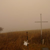 In the fog I catch sight of the cross memorial to the two dead hikers of a 100 years ago.
