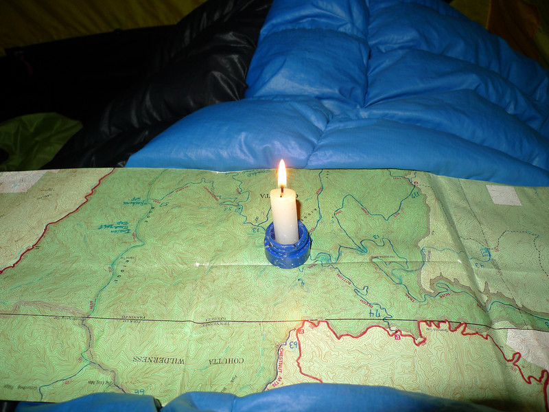 The best way to keep fingers warm on cold winter nights in the tent is to a lit candle.