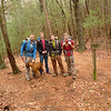 A group of 4 backpackers and a dog pass thru Low Gap on their way to Grassy Gap and points elsewhere.<br /> <br /> JOURNAL<br /> <br /> DAY THIRTEEN TRIP 142<br /> <br /> TRAIL Big Creek/Yellow Stand Lead<br /> CAMP Log Gap<br /> <br /> OH COLD DARK THIRTY<br />     It's 4 in the morning on the banks of Big Creek as I go out to look at the fairly clear sky and return to the tent in a hurry because it's below freezing again for the 5th or 5th night in a row so my torso is cold and my arms get weird. Now I sit up in the tent under the bag to write but it won't be for long, adieu and back to the sleeping state if possible.<br /> <br /> 8 A.M. TEA<br />     It's ginseng and nettle and peppermint---4 bags---with one slice of Ezekiel whole grain bread. After tea the plan is to pack with not alot of conscious thought and hit the Big Creek trail out to the road and in 50 feet connect to the Yellow Stand Lead trail which will take me to Low Gap in 2.5 miles from my Big Creek campsite and get there before the scheduled rainstorm later today.<br /> <br /> CLIMBING YELLOW STAND LEAD<br />     I'm at the beginning of leg 5 where the trail enters the wilderness by the sign and where the trail switches over to the sunny Big Frog Mt side of the ridge. It's a climb all the way so just take a few breaks and drink your cold tea.<br /> <br /> TRUCKS AND BONOBOS<br />     I hear a few faint trucks off I-64 but it's par for the course in this day and age of the holy automobile. You'd have to go to Denali or Everest to escape it but then you'd be bombarded with airplanes and helicopters. It's the bonobo fascination with gasoline engines and the joy of noise and the lazy desire for quick and easy access. Why climb Everest when you can land a helicopter on top? Why climb Denali where you can fly over it? Why hike the Ocoee when you can drive its length and gawk out the car window?<br /> <br />     The head honchos long ago decided after they killed off or moved the Cherokee and the Creeks t
