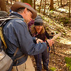 Kellie and friend inspects the map on the Rough Creek trail.