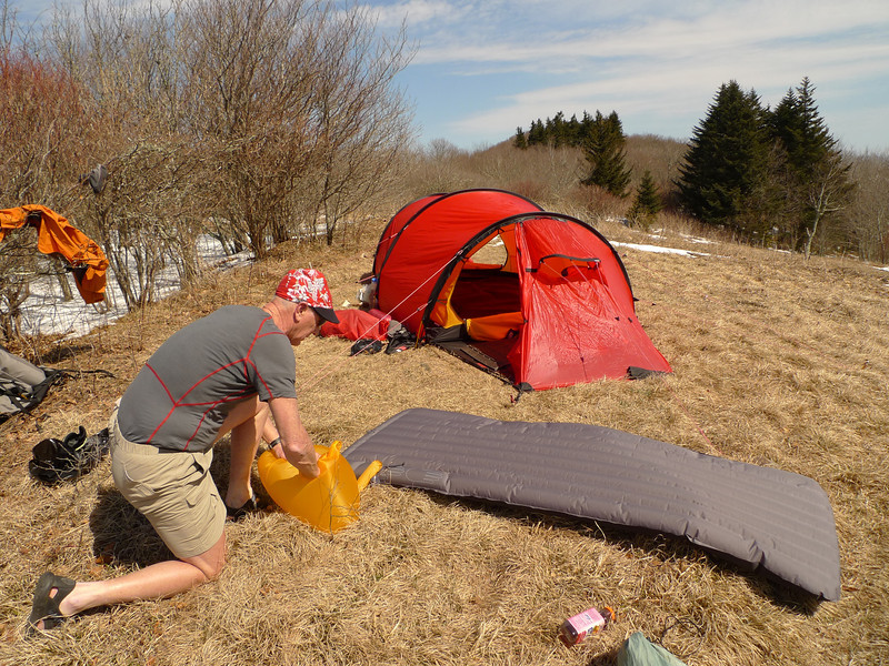 John sets up his new red Hilleberg Kaitum and blows up his Exped downmat---all good stuff for a winter trip.