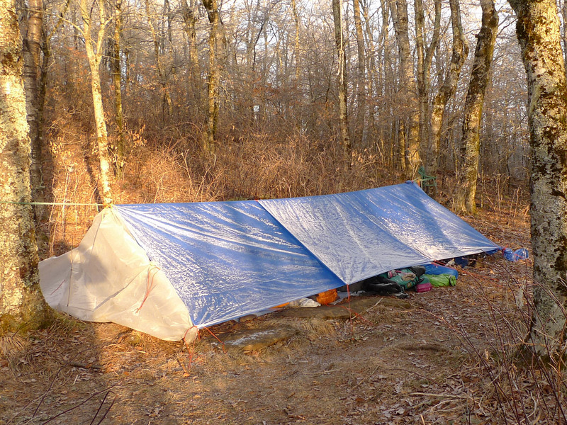 The night of Day 6 is butt cold with temps around 12F or so it seems because the wind is rough.  Here's the frosty student's tarp but everyone's still in bed.