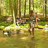 I take a long video of the girl crossing Slickrock Creek and here are some stills.<br /> <br /> JOURNAL<br /> <br /> DAY THREE   TRIP 145<br /> <br /> TRAIL South Lead/Big Fat Gap Trail/Slickrock Creek<br /> CAMP Little West<br /> <br /> WINDY ON THE MOUNTAIN<br />     I go out at 5 in the morning and tighten 9 of the stake outs as there are frequent mad gusts slamming the tent back and forth. Afterwards I decide since I'm up to brew a pot of cranberry and nettle tea with honey and let it cool while listening to the wind.<br /> <br /> VOICES<br />     Last evening I kept hearing voices in Saddle Tree Gap and so I imagine and assume there are backpackers camping either at Bree Camp or further up at the tree camp on the ridge which Patman once used. I almost went to Bree Camp yesterday but figured Clearcut Camp is good enough once the sun went down far enough to keep camp cool. Once again there is no shade as it's May at 5,000 feet and there are no leaves yet on the trees---a no-brainer in clearcut camp as there are no trees thanks to the Graham County forest service and the Cheoah Ranger District.<br /> <br /> 9 HIKERS FROM INDIANA<br />     They pass my camp before sunrise to catch it on the overlook and an hour later pass back to their camp near Saddle Tree Gap (it's actually all the way back in Naked Ground). They are from the College of St Francis.<br /> <br /> HARD TO DO<br />     I left Hangover Mt and I'm going down the South Lead trail with my red Felco loppers in one hand and my hiking pole in the other and clearing the trail all the way to Elysium Fields. It's hard to do because the trail is treacherous with an 80 lb pack while at the same time clipping out rhodo and briars and brush. Thankfully the trail is in pretty good shape already and so all I am doing is trimming out the crap that's in a backpacker's face. I'm resting on the finger above Elysium Fields and should be in the gap after another hour of backpacking trailwork. I couldn't be doing this trai