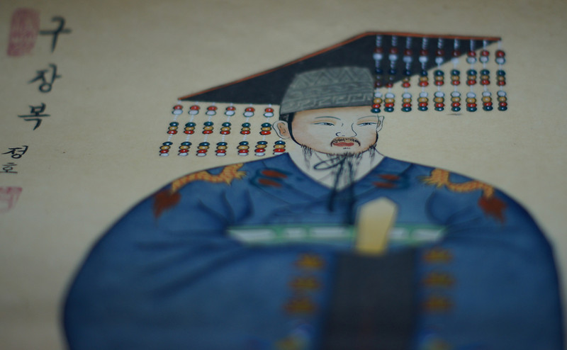 A close up shot of a traditional Korean scholar.