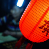 A red lantern with Chinese characters lit up at night - Insadong, Seoul, Korea.