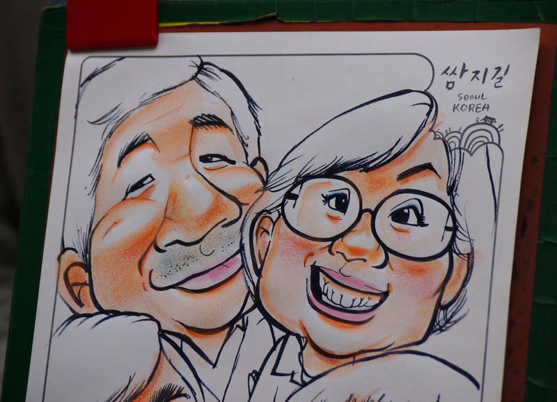 A caricature of a Korean couple drawn in a mall area of Insadong - Seoul, Korea.