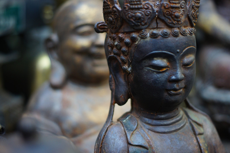 This is a close up shot of a Buddhist statue on sale.