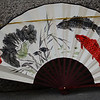 This is a traditional Korean fan with flower and fish arrangements skilfully painted on it.