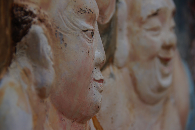 Distinct Facial sculptures on the wall.