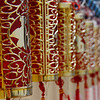 Ornamental glass decorations lined up in a row.