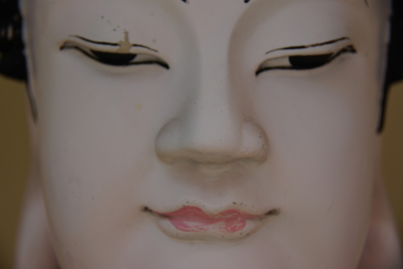 A close up shot of a Buddhist face.