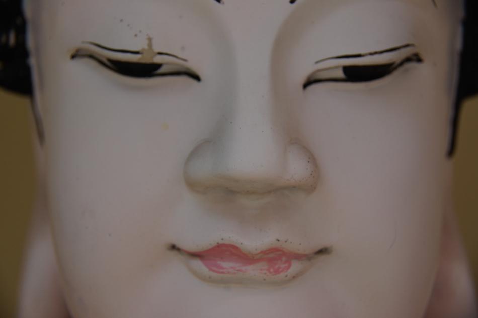A close up shot of a Buddhist face.