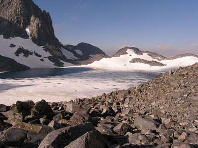 Finally over N. Glacier Pass, a look at partially frozen Lake Catherine