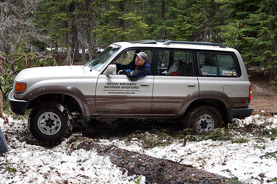 Steve takes his Land Cruiser over a few downed trees on the way to Clover Springs