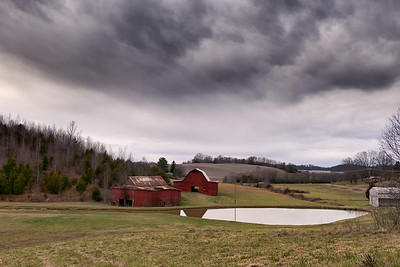 Barns, pond, and rolling hills