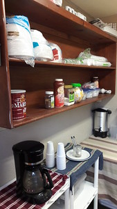 Move large shelf from radio romm to kitchen area, more space now