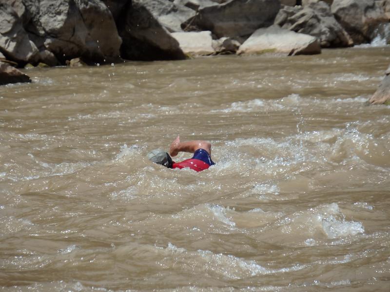 Tauri Swimming Across the River