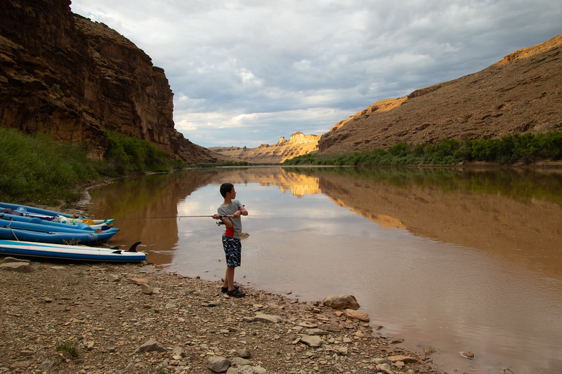 Alex Fly Fishing From Camp